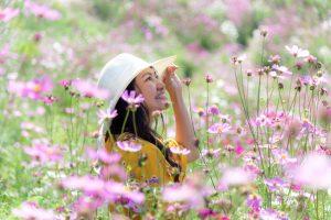 Woman in Field of spring Flowers Happy